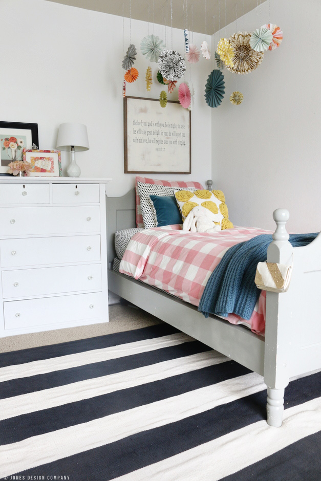 Classically Cute Girl's Bedroom with mixed patterns and girly colors. Buffalo check duvet, striped rug. / jones design company