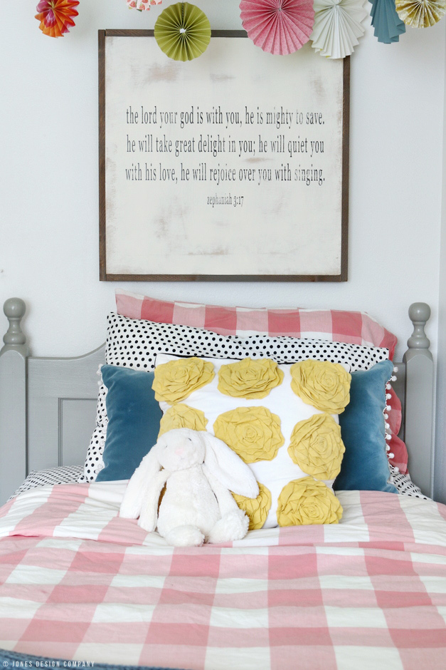 Classically Cute Girl's Bedroom with mixed patterns and girly colors / jones design company